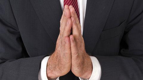 wpid-praying-suit.jpg