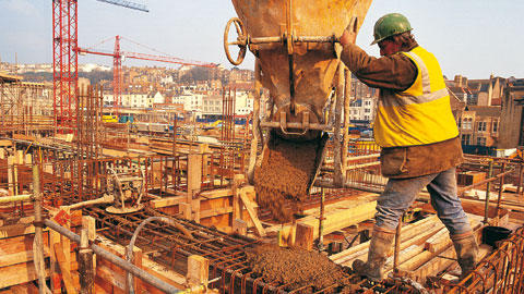wpid-construction-worker-pouring-concrete.jpg