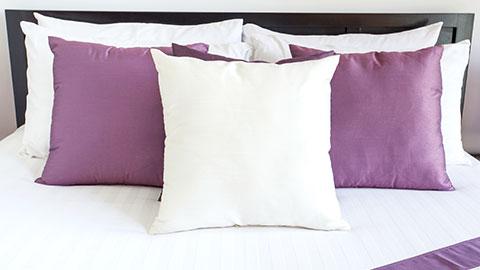 wpid-pillows-on-bed.jpg