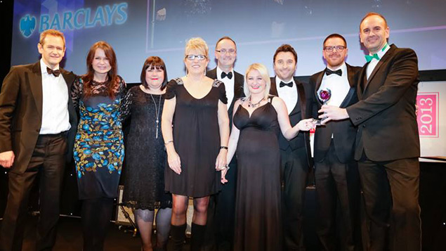 Barclays collect their trophy for the award for Youth Employment Initiative