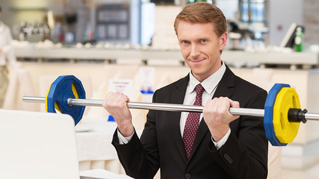 Office worker lifting weights