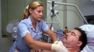 NHS nurse attending to a patient