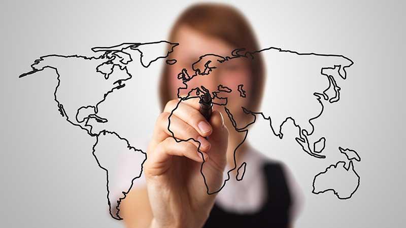 Woman drawing world map