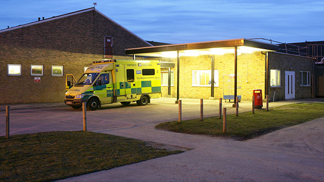 NHS ambulance parked outside building