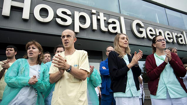 Nurses at the hospital in Madrid, where nurse Teresa Romero was infected with Ebola, protest at spending cuts. REX/ZUMA