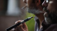 Vaping e-cigarettes in the workplace is not the same as smoking. Photo: Sarah Alcalay/SIPA/REX