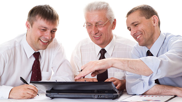 three-men-working-on-pc