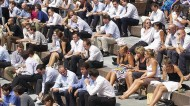 What is the maximum workplace temperature? City workers head outside to enjoy the sunshine. Photo: REX