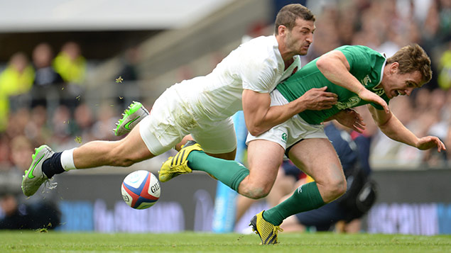 England's Jonny May tackles Eoin Reddan of Ireland at a warm-up game for the Rugby World Cup 2015. Photo: Javier Garcia/BPI/REX