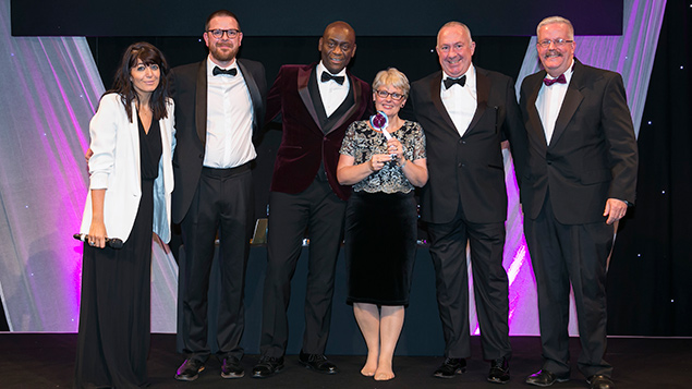 Savills accept their award for learning and development in an organisation of 1000+ people.
