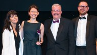Harris + Hoole could not attend so XpertHR's Madeleine Graham collected the trophy on their behalf