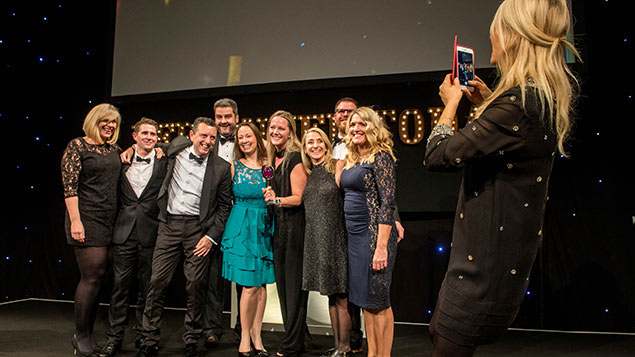 2016 guest host Gaby Roslin takes a photo of SAB Miller's winning team