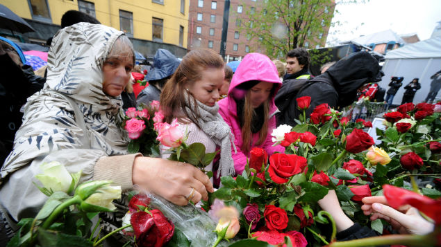 People leaving flowers outside the courthouse during the trial of Anders Behring Breivik, responsible for a terrorist attack on a Norwegian summer camp in 2011. Allover Norway/REX/Shutterstock
