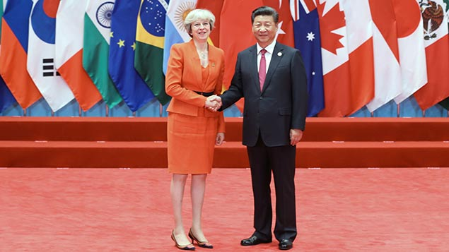 Theresa May arrives in China for the G20 where she rejected the idea of points-based immigration rules for EU workers. Photo: Xinhua News Agency/REX/Shutterstock