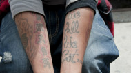 Sign of the times? Employers are challenged to change view on tattoos.  Pic: Janinne Wiedel/REX/Shutterstock