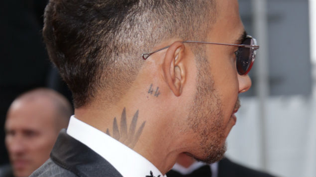 Racing driver Lewis Hamilton sporting visible tattoos. Pic:Matt Baron/REX/Shutterstock
