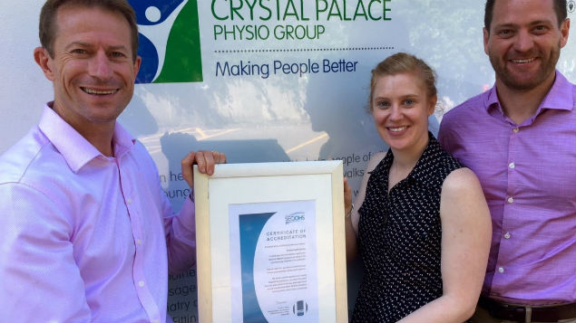 Stuart Paterson, director of Crystal Palace Physio Group, Kathryn Moore, OH physiotherapist  and Miles Atkinson, head of OH services hold the first  SEQOHS accreditation certificate gained by an OH physiotherapy service.