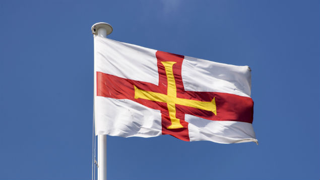 The Guernsey flag: the island  has overhauled sickness absence and sick pay  with emphasis on return to work after illness. Photo: Richard Sowersby/REX/Shutterstock
