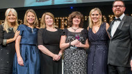 Law firm Pinsent Masons collect their diversity and inclusion trophy in 2016 from Charlotte Sweeney, founder of Creating Inclusive Cultures