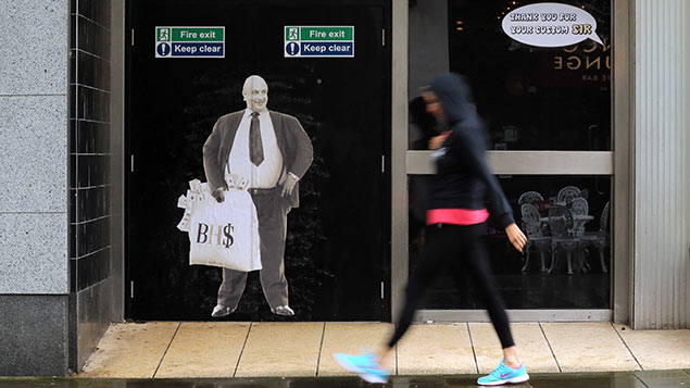 A satirical poster of Sir Philip Green on the door of a now closed down BHS storeDimitris Legakis/REX/Shutterstock