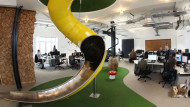 'Quirky' facilities such as slides are not as popular with employees as businesses might thinkSolent News/REX/Shutterstock