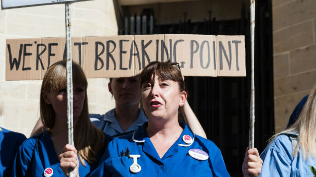 Nurses gather outside the Department of Health on the NHS's 69th birthday to protest against the pay restraint. Nurse numbers are now worryingly low. PHoto: Wiktor Syxmanowicz/Shutterstock