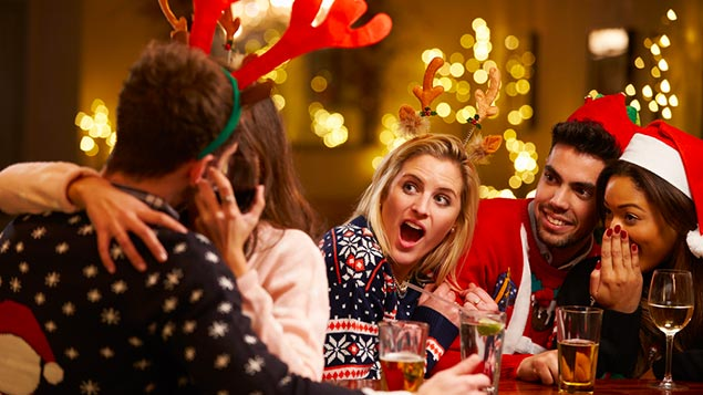 Men are more likely than women to think it acceptable to kiss a colleague at a Christmas party