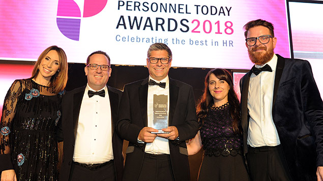 Members of the Evershed Sutherland team receive their Employment Law Firm of the Year award from the One Show's Alex Jones and Rob Moss, editor of Personnel Today.