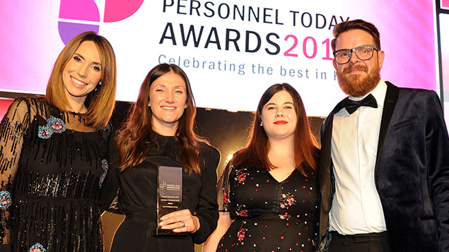 Members of the Secret Intelligence team, flanked by Alex Jones and Personnel Today editor Rob Moss collect their Innovation in Recruitment Award at the Personnel Today Awards 2018