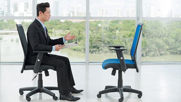 Man interviews an empty chair