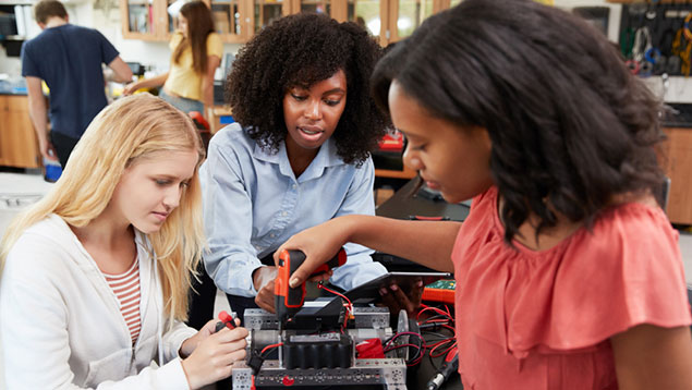 Young women students in robotics