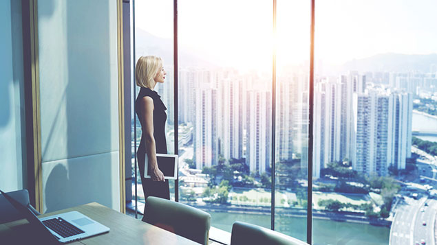woman gazing out of modern office
