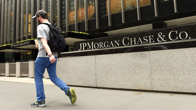 man passes by JP Morgan office