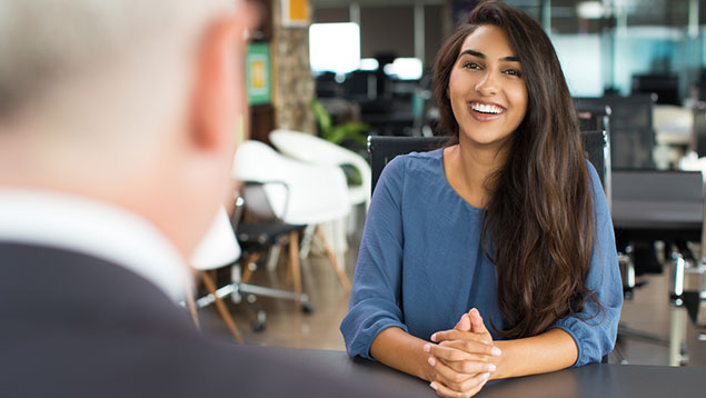 Young smiling woman at job interview