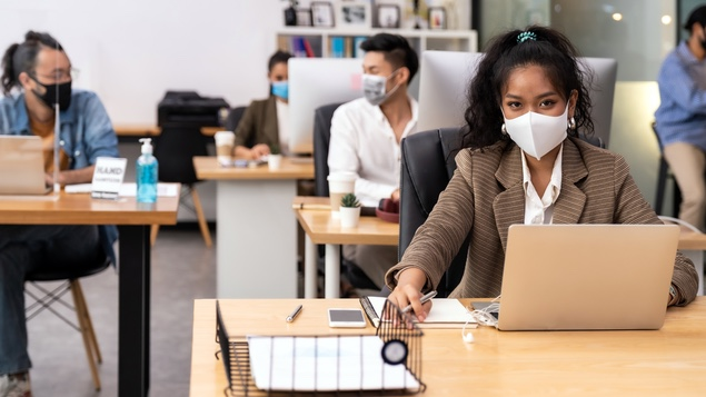 workers in office with masks