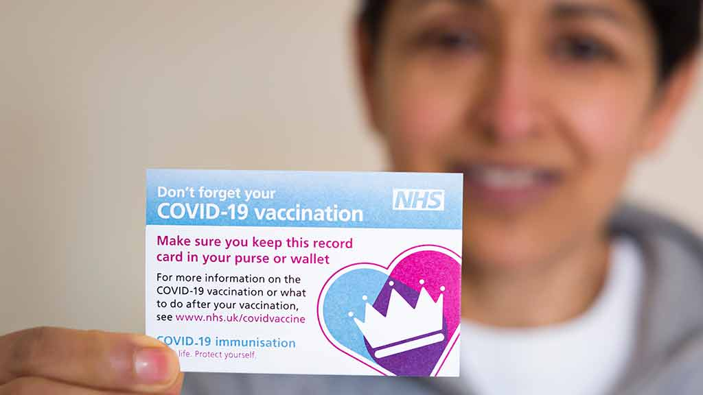 Covid-19 vaccination card. Paul Maguire / Shutterstock